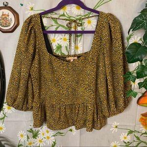 Evolutionary mustard yellow leopard peasant blouse